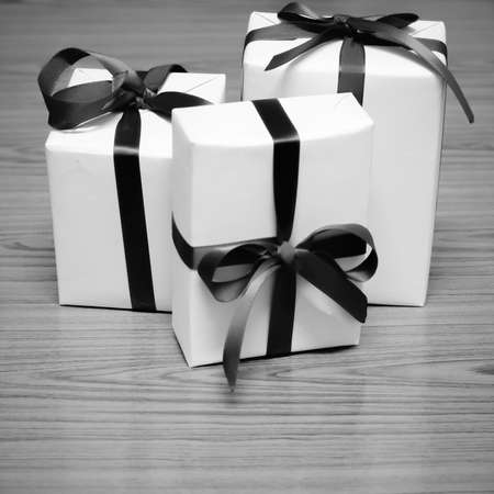 ribbin: gift box and ribbin on wood black and white color tone style Stock Photo