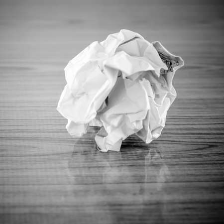creasy: crumpled paper on wood black and white color tone style Stock Photo