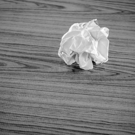 wastrel: crumpled paper on wood  black and white color tone style