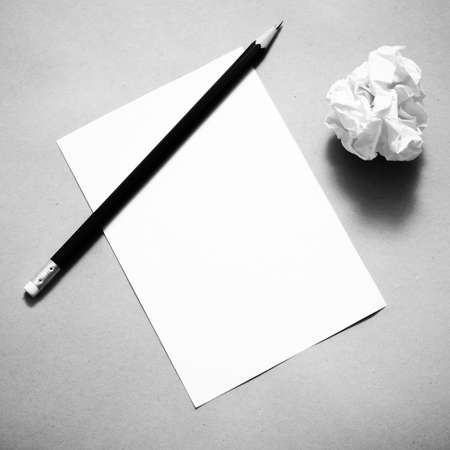 writer's block: Pencil on clear paper with crumble paper balls on brown color background black and white color tone style