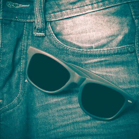 ray ban: sunglasses on jean pants retro vintage style