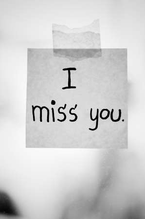 i miss you: I miss you word sticky note on window mirror black and white color tone style