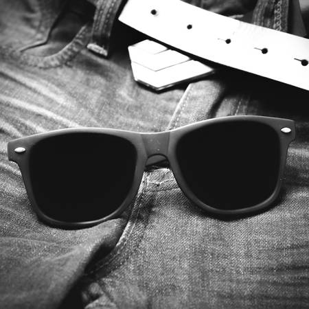 ray ban: sunglasses on jean pants black and white tone color style