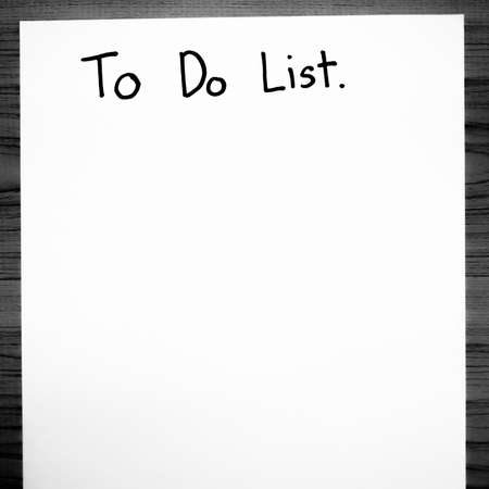 enumeration: paper write to do list word on wood background black and white color tone style Stock Photo