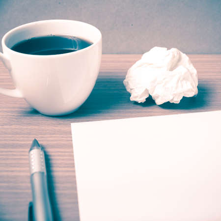 paper and crumpled with pen and coffee cup on wood background vintage style