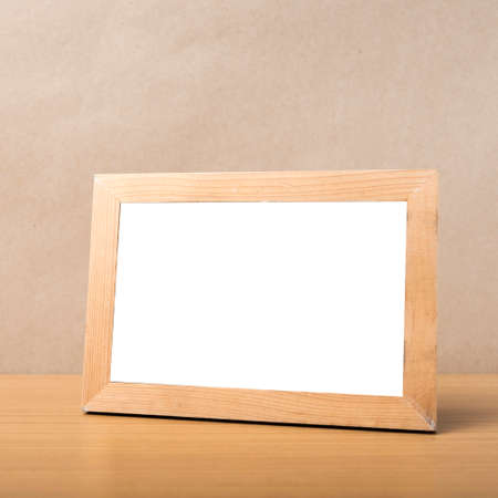 pictures: picture frame on wood table background