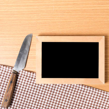 restaurant questions: blackboard and knife on table