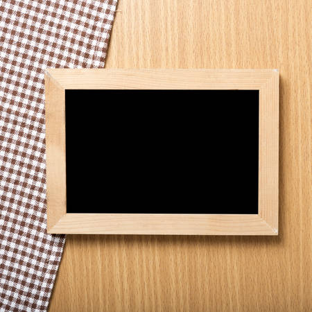 restaurant questions: blackboard and kitchen towel on table Stock Photo