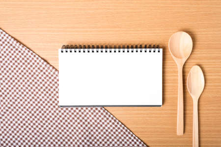 notebook and kitchen tools on table