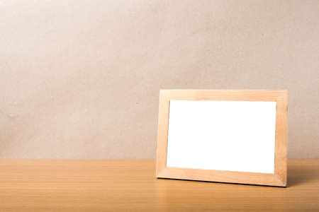 picture frame on wood table background
