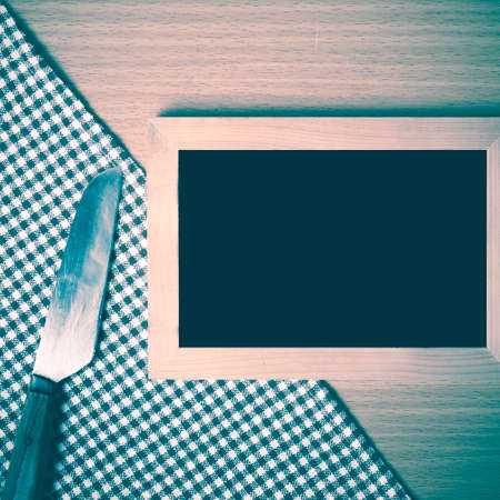 restaurant questions: blackboard and knife on table vintage style Stock Photo