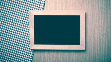 restaurant questions: blackboard and kitchen towel on table vintage style Stock Photo