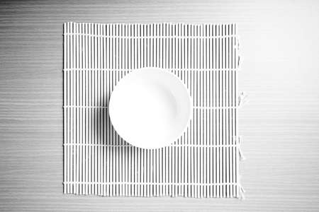 empty bowl: empty bowl on mat black and white color tone style