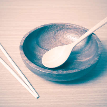 empty bowl: empty bowl with chopstick on wood table background vintage style