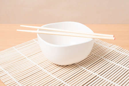 empty bowl: empty bowl with chopstick on wood table background Stock Photo