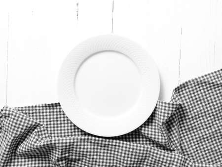 dishtowel: empty dish with kitchen towel over table background black and white tone color style