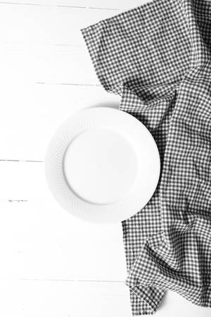 dishcloth: empty dish with kitchen towel over table background black and white tone color style