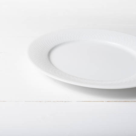 lunch table: empty dish over white table background Stock Photo