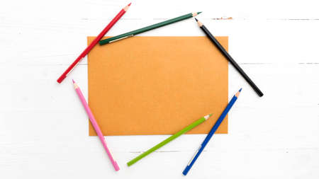 coloring sheets: brown paper with color pencil on white table