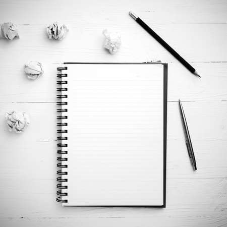 writer's block: notepad and crumpled paper on white table black and white style Stock Photo