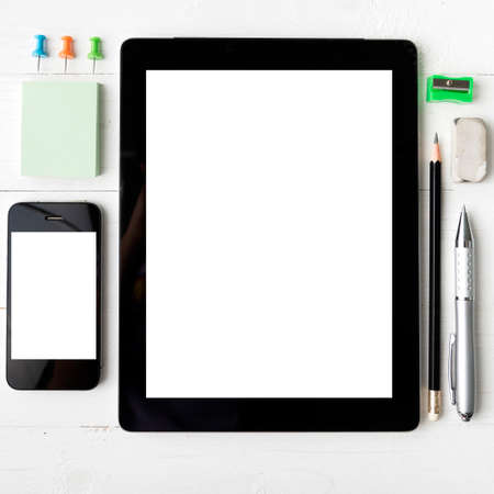 office view: tablet and cellphone with office supplies over white table Stock Photo