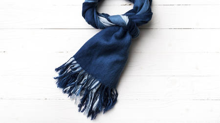 silk scarf: blue scarf over white wood table background