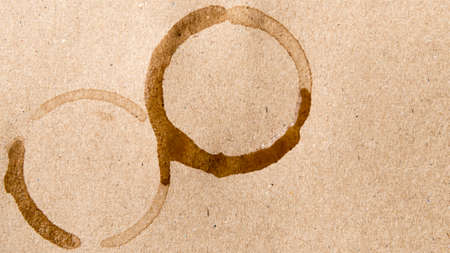 stain: coffee cup stain over brown background