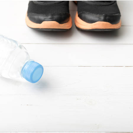 water shoes: running shoes and drinking water on white table