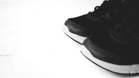 athletic wear: fitness eqiupment:running shoes black and white color style