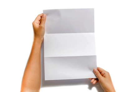 hand holding paper: woman two hands holding blank paper a4 size on a white background Stock Photo