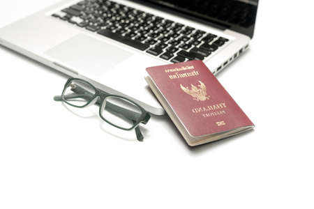 fiestas electronicas: passport laptop and eyeglasses isolated on white background Foto de archivo