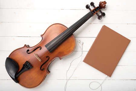 audio book: violin with notebook and earphone