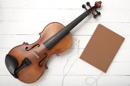 earphone: violin with notebook and earphone