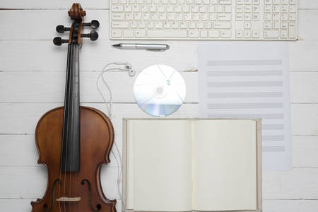 keyboard computer with notebook dvd disc and violin on white background Stock Photo