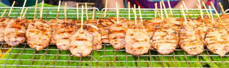 grilled pork at Jatujak market,Bangkok Thailand. Imagens