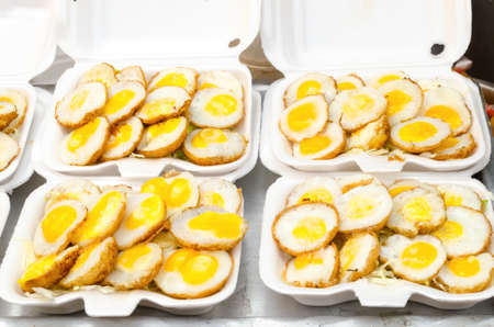 Selling Fried quail egg Thai food in foam container at Jatujak weekend market,Bangkok Thailand.