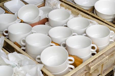 selling ceramic tableware at Jatujak weekend market,Bangkok Thailand. Imagens