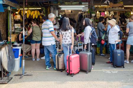 BANGKOK,THAILAND - 19 FEBRUARY 2017 :  tourist shopping in Chatuchak weekend market outdoor in sunny day Bangkok Thailand background.