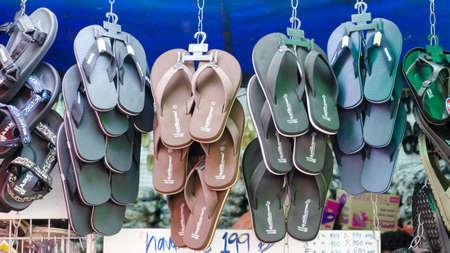 soft sell: BANGKOK,THAILAND - 19 FEBRUARY 2017 : hanging of sandal selling at Jatujak weekend market. Editorial