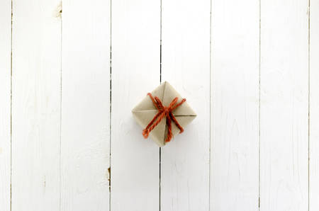 top view of craft gift box on white wood background