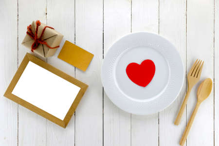 top view of craft box with dish and spoon fork on white wood background