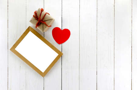 top view of craft gift box with photo frame and heart concept valentine day
