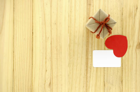 top view of craft gift box with heart on wood background concept lovetop view of craft gift box with heart on wood background concept love Imagens