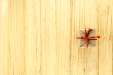 top view of craft gift box on wood background