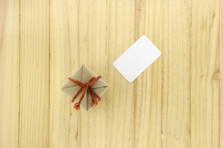 top view of craft gift box and card on wood background Imagens