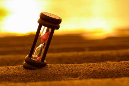Closeup of hourglass on the sand Timer Beach Sunrise