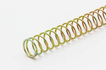 coil springs: Macro spring steel isolated on white background