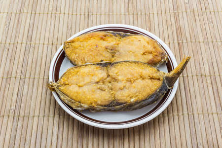 Salted fish fried (King mackerel) on a plate and eat.