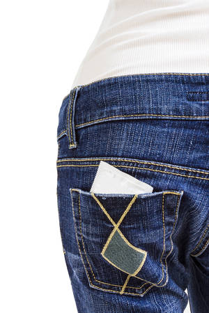 Condom  in the back pocket of blue jeans on white background photo