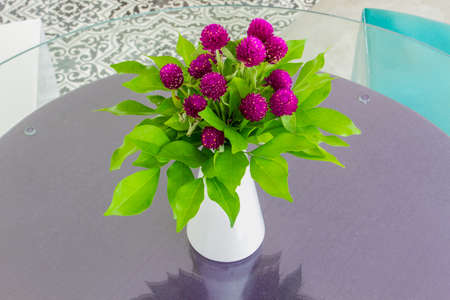 Globe amaranth in a vase on the table. photo